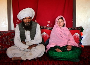 "A ""wedding"" couple in Afghanistan: Mohammed, 40, and Ghulam, 11. (CC AP / UNICEF / Stephanie Sinclair NC)"