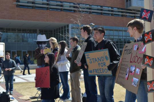 Georgia Tech students, led by Dustin Hsu (center right), Stand for Freedom. (Photo: Lauren Brett)
